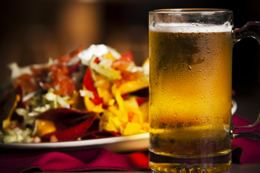 Food and Drink: Closeup Appetizer Spicy Nachos Cold Beer