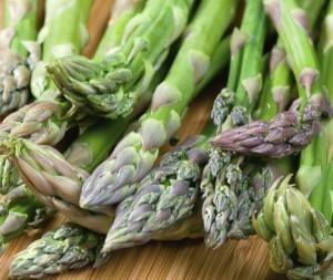 Fresh green asparagus on cutting board